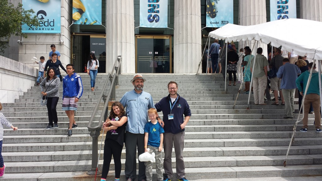 Lawrence and his two children standing outside the Shedd Aquarium in Chicago