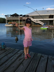 Young Girl Guide holding a fish