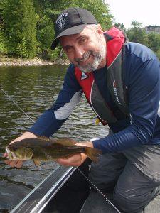 Lawrence releasing an 18-inch Walleye