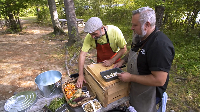 Chef Steve Mitton and Angler Lawrence Gunther in their outdoor kitchen