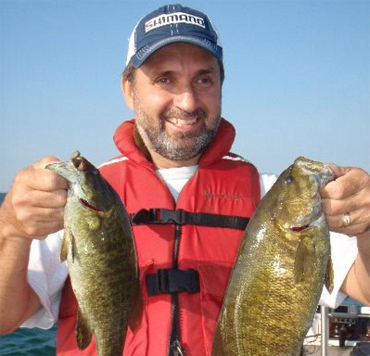 Photo of Editor Lawrence Gunther with a couple Lake Erie Smallmouth